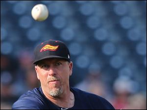 Mud Hens third baseman Mike Hessman makes a throw to first base.