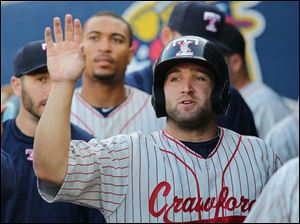 Toledo Mud Hens' Tyler Collins celebrates scoring against the Lehigh Valley Iron Pigs.