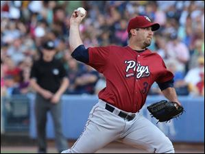 Lehigh Valley Iron Pigs pitcher Brad Lincoln throws against the Hens.