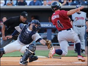 Toledo Mud Hens catcher Manny Pina tags out Lehigh Valley Iron Pigs base runner Clete Thomas during the second inning.