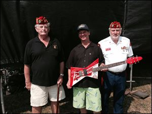 Mike Mori, director of the Northwest Ohio Rib-Off and director of sales for The Blade, is flanked by Ronald Schramm, left, and Bob Baker from the Blue Diamonds Detachment Marine Corps League. Mr. Mori said attendance for the four-day event was about 60,000 people.