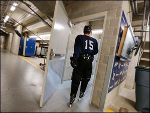Blue team member Corey Suba, of Livonia, Mich., heads for the ice.