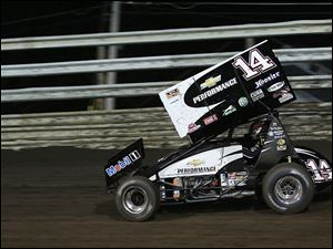 Tony Stewart races a sprint car in Oskaloosa, Iowa, last year. Stewart broke his leg in the race. He was driving a similar car when he struck and killed a driver last week.