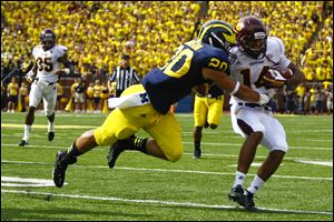 Michigan's Drake Johnson tackles Central Michigan's Jason Wilson during an Aug. 31, 2013, game at Michigan Stadium in Ann Arbor. The The redshirt sophomore missed last season after tearing his ACL during that game, and he didn't resume practicing until this summer.