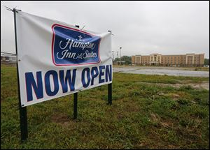 New Hampton Inn on Secor Road is open, while work on a Holiday Inn Express will begin in March.