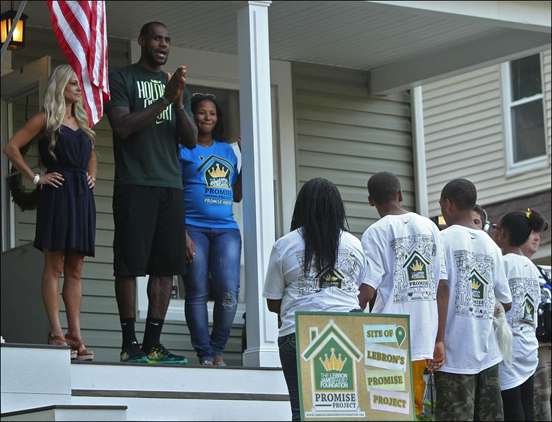 NBA star LeBron James tours renovated home of Akron family, shoots baskets with kids - Toledo Blade
