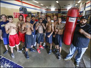 Glass City Boxing Gym team members from left: coach Dave Rayman, Elias Moreno, Angelo Snow, DeAndre Ware, Jr., coach Gabe Morris, Wesley Tucker, coach Ray Vargas, Jamal Brown, Jeremy Caughhorn, Tyler McCreary, and coach Lamar Wright, Jr. are ready for Friday's nine-bout card.