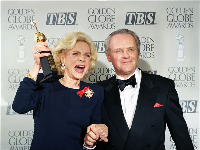 Obit Lauren BacallLauren Bacall holding u Lauren Bacall holding up her Cecil B. DeMille Award for Lifetime Achievement as she holds hands with actor Anthony Hopkins backstage at the 50th annual Golden Globe Awards in Beverly Hills, Calif on Jan. 23, 1993.