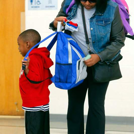 CTY-backpacks14pLaticia-Holmes-right-helps-p