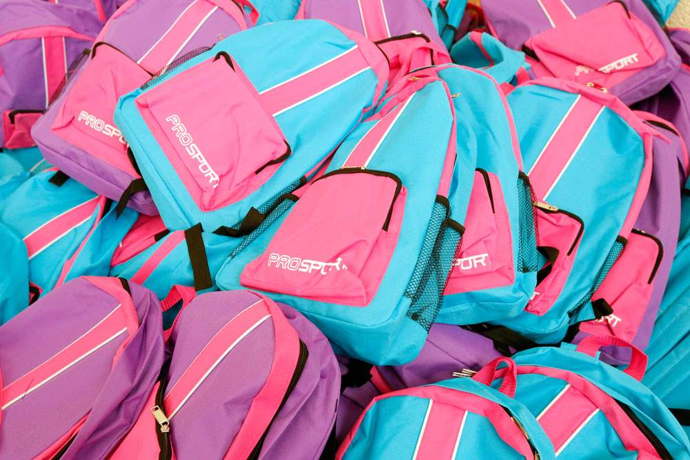 CTY-backpacks14pA-mountain-of-girl-s-backpacks-to-be-distributed