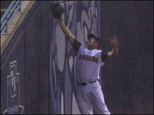 Toledo left fielder Tyler Collins leaps against the wall but can't reach this foul ball.