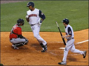 Toledo's Daniel Fields passes Indianapolis catcher Tony Sanchez after hitting a home run bottom of the 5th inning.
