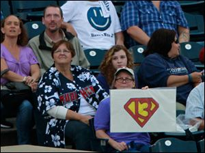 A Toledo Mud Hen fan hopes James McCann, No. 13, has super powers during his time at bat.