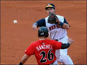 Indianapolis' Tony Sanchez is out on this double play turned by Toledo second baseman Brandon Douglas.