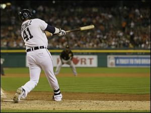 Detroit Tigers designated hitter Victor Martinez connects for a two-run single during the seventh inning of an interleague baseball game against the Pittsburgh Pirates, Wednesday, Aug. 13, 2014 in Detroit. (AP Photo/Carlos Osorio)