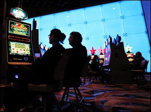 Gamblers who patronize the Hollywood Casino Toledo, which now is subject to Ohio's strict ban on smoking inside public places, may soon be able to puff away while playing on machines outdoors.