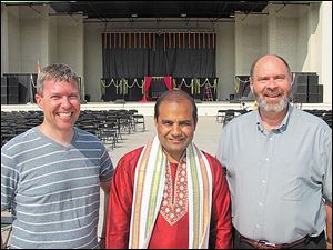 From left, Father Kent Kaufman, All Saints Roman Catholic Church, Rossford, Annat Dixit, the priest at the Hindu Temple, and Father Tim Philabaum, Zoar Lutheran Church, gather for a photo at the festival of India