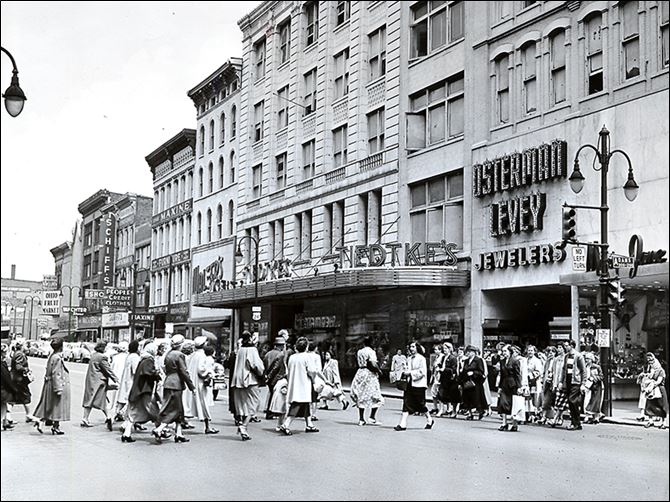 n5tiedtke-7 Crowds head to Tiedtke's Department Store downtown in 1953.