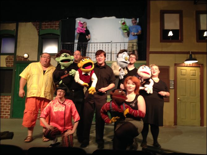 photo_2.JPG Cast members rehearse a scene in '‍Avenue Q,' the musical comedy that teaches that adulthood is not as fun as it looks. The Fort Findlay Playhouse production opens tonight.