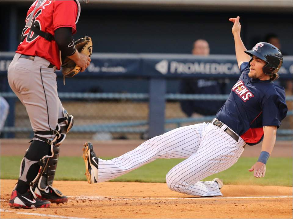 Toledo Mud Hens first baseman Jordan Lennerton scores in front of Indianapolis Indians catcher Tony Sanchez during the fourth inning.