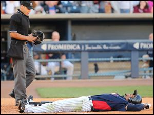 Toledo Mud Hens' Daniel Fields is hit by a pitch against the Indianapolis Indians during the third inning.