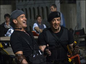 "Antonio Banderas, left, and Sylvester Stallone on the set of ""Expendables 3."""