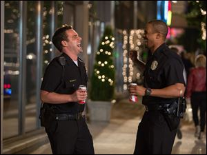 "Damon Wayans, Jr., right, and Jake Johnson in a scene from, ""Let's Be Cops."""