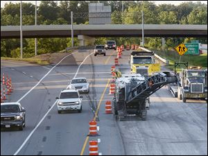 Kokosing Construction Co. crews remove pavement on southbound I-75 at the I-475 split in Toledo.