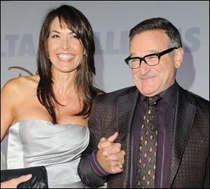 Actor Robin Williams, right, and  his wife Susan Schneider in this 2009 file photo.