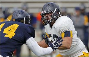 Toledo's Josh Hendershot, right, is one of five seniors slated to start on the offensive line for the Rockets.