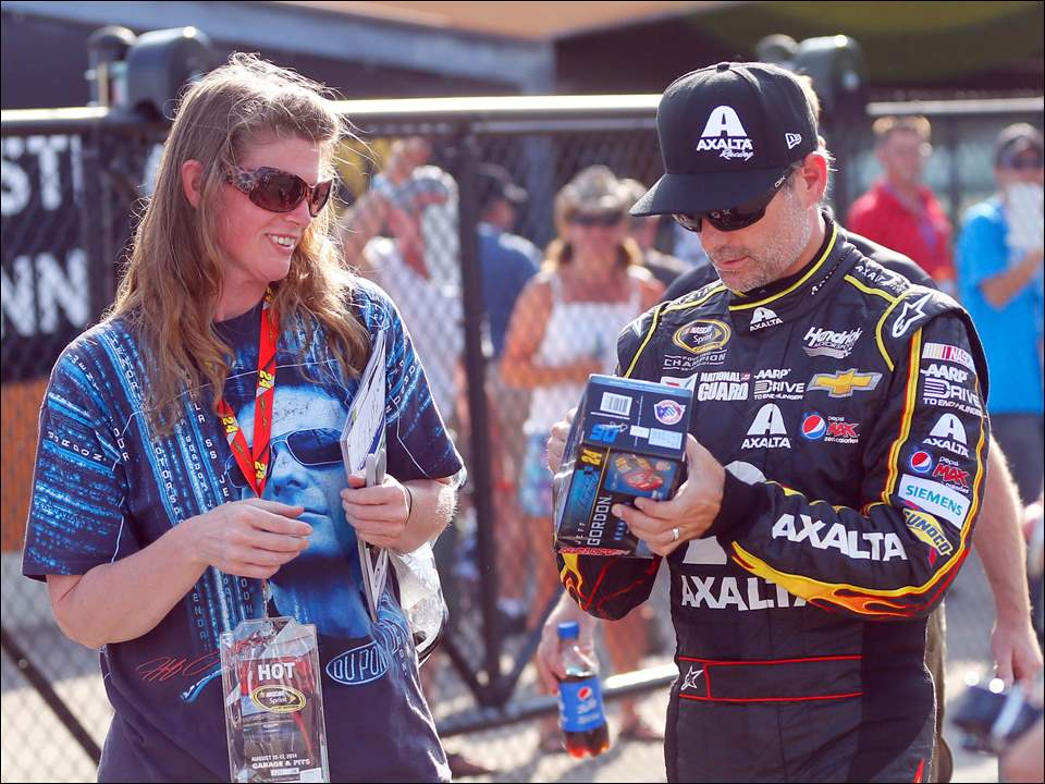 Jeff Gordon signs an autograph outside of the track after winning the pole.