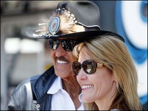 Richard Petty, left, poses with fan Kathleen Strauss, right, from San Diego, Calif.