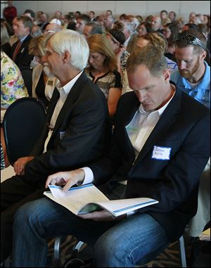 CTY watercausus16p  08/15/2014  The Blade/Lori King  Jason Kolb, of Algix Water Solutions, reads during a special Lake Erie Legislative Caucus meeting at Maumee Bay State Park in Oregon, Ohio.