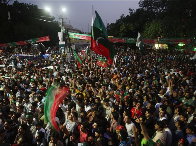 Thousands of opposition protesters on Thursday joined large convoys headed to Pakistan's capital Islamabad for a mass rally to demand the ouster of the prime minister over allegations of vote fraud.