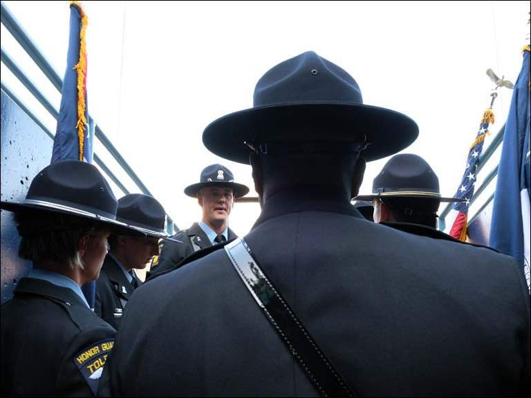The Toledo Police Honor Guard prepare to present the colors for the Toledo Mud Hens game Friday at Fifth Third Field.