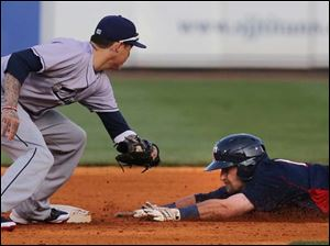 Toledo's Brandon Douglas steals second base against the Columbus Clippers player Justin Sellers during the third inning.