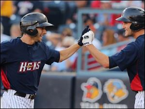 Ben Guez, left, celebrates  hitting a home run against the Columbus Clippers with designated hitter Wade Gaynor.