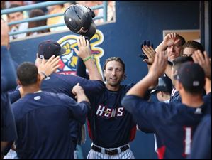 Toledo's Ben Guez  celebrates hitting a home run against Columbus as a he returns to the dugout.