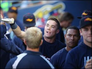 Mud Hens catcher James McCann celebrates hitting a home run against the Clippers during the fourth inning.