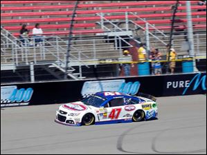 AJ Allmendinger drives around the track during practice.