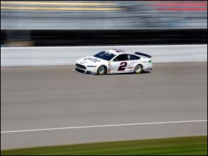 Brad Keselowski drives around the track during practice.