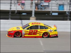 Joey Logano drives around the track.