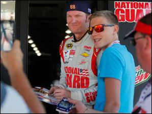 Dale Earnhardt Jr. poses with fan Tanner Siwecki, 16, right, of Gaylord, Mich..