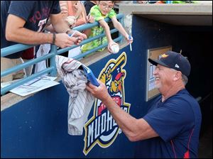Mud Hens manger Larry Parrish signs autographs for fans prior to the team's game against the Columbus Clippers.