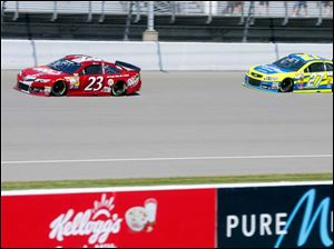 Alex Bowman, front, and Paul Menard, back, drive during practice.