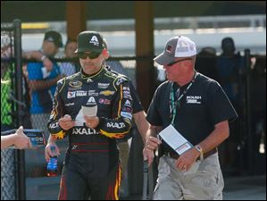 Jeff Gordon walks out of the track after winning the Pole during the NASCAR Sprint Cup Series Qualifying.