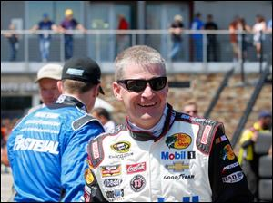 Jeff Burton walks to the garage during practice. He will race in place of Tony Stewart.