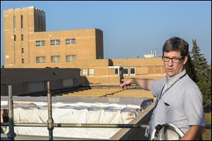 Andrew McClure, Collins Park Water Treatment Plant superintendent, points out the roofing replacement on Toledo's treatment facility. The plant was built in 1941.