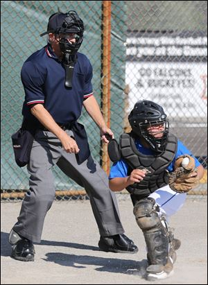 Brondes catcher Ethan Bennett, 9, makes the catch as Mr. Walton looks on.