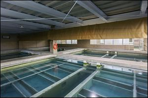 Water slowly filters in pools inside the Collins Park Water Treatment Plant in East Toledo. The plant began an ongoing $264 million upgrade of its facilities last year.